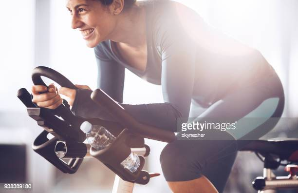 young happy sportswoman having exercising class on sports training in a health club. - peloton stock pictures, royalty-free photos & images