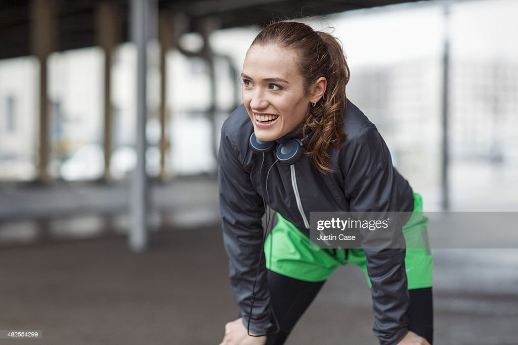 young happy woman catching her breath after sport : Stock-Foto