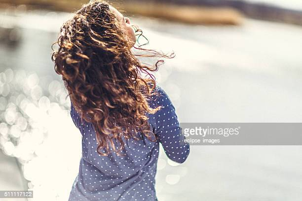 Young happy woman enjoying in day