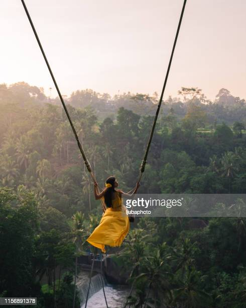 young happy woman enjoying in her day at nature. - swinging stock pictures, royalty-free photos & images