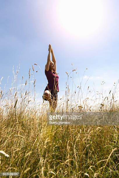 young happy woman enjoying yoga in nature