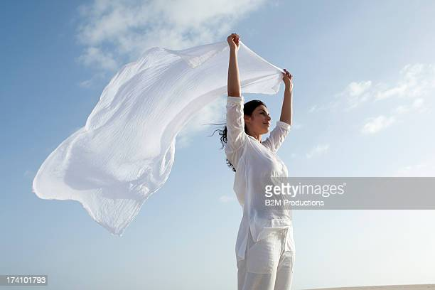Young Happy Woman Holding Scarf