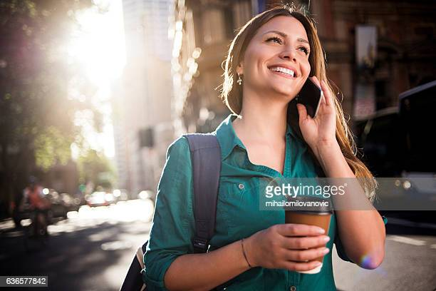 Young happy woman on the phone