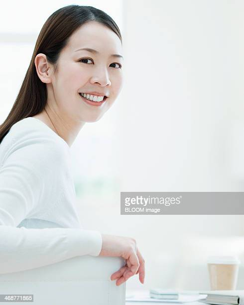 Young Happy Woman Sitting On Chair