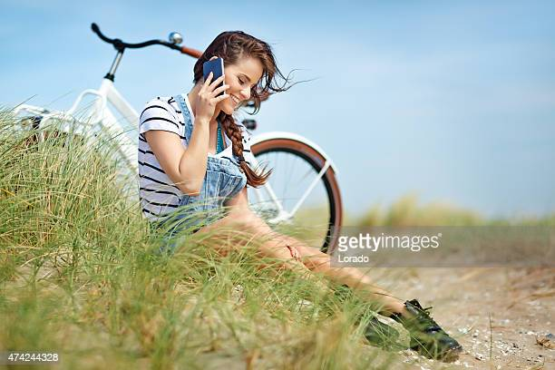 young happy woman talking on the phone outdoors