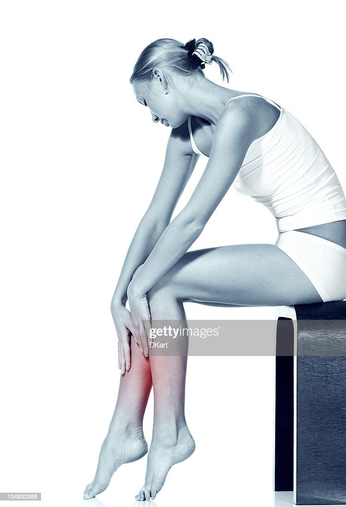 young harmonious girl massages the thin and long tired feet. : Stock Photo