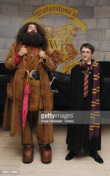A young Harry Potter fan poses as a character at the sale of the new JK Rowling book Harry Potter and the Deathly Hallows at Waterstone's Piccadilly