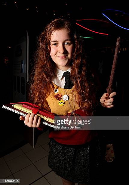 A young Harry Potter fan poses in costume ahead of the first public screening of the final Harry Potter film 'Harry Potter and the Deathly Hallows...