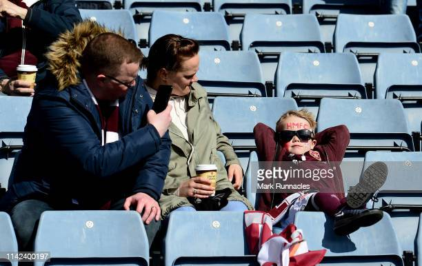 A young Heart of Midlothian FC fan enjoys the pre match sun prior to the Scottish Cup Semi Final match between Heart of Midlothian and Inverness...