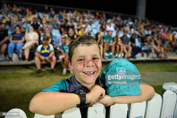 A young Heat fan shows his support during the Women's Big Bash League match between the Brisbane Heat and the Melbourne Stars on January 13 2018 in...