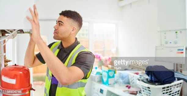 young heating engineer - service stock pictures, royalty-free photos & images