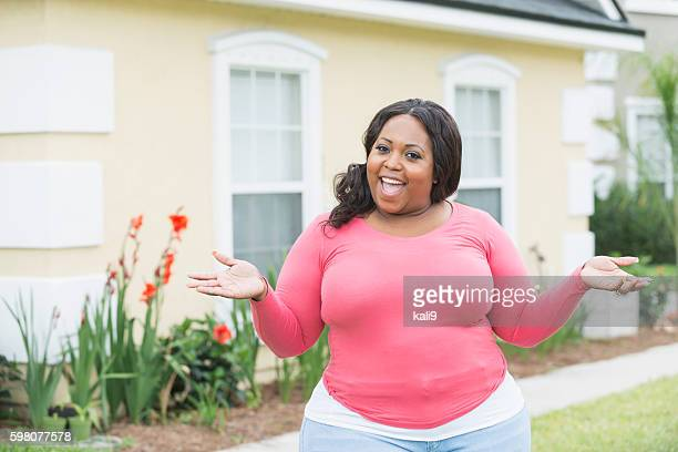 young heavyset african american woman outside home - images of fat black women stock photos and pictures