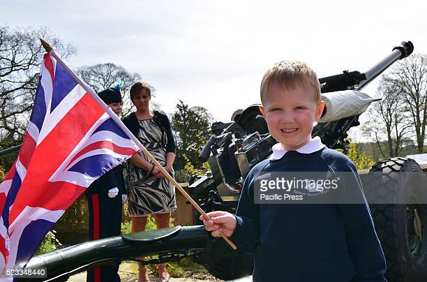 Young Henry Dunlop age 4 from Barbour Nursery school who is also the 4th Generation of village farmer flies the Union Flag to celebrate the Queens...