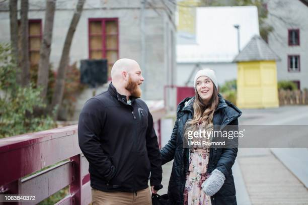 young heterosexuel couple walking in old montreal - traditionally canadian stock pictures, royalty-free photos & images