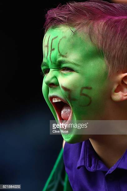 A young Hibernian fan sings during the Scottish Cup Semi Final between Hibernian and Dundee United at Hampden Park on April 16 2016 in Glasgow...