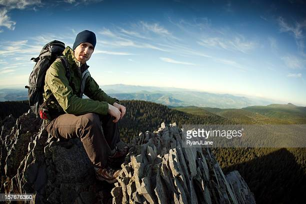 young hiker at mountain top - windbreak stock pictures, royalty-free photos & images