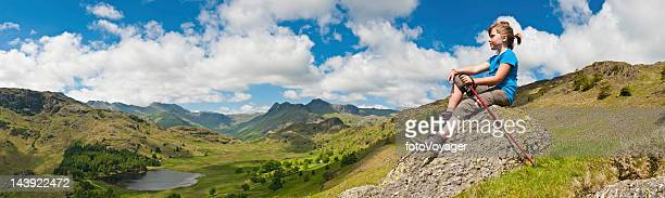 young hiker looking over idyllic mountain vista - cumbria stock photos and pictures