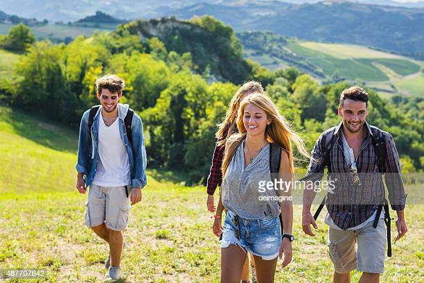 Young hikers walking the hills