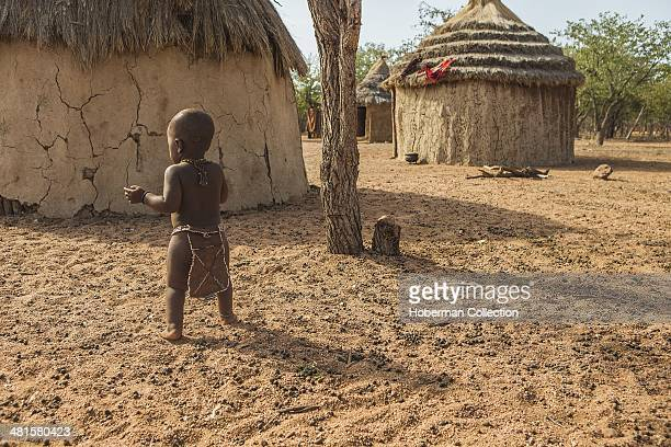 Young Himba Boy in his traditional outfit The people of the Himba tribe belong to the last nomadic people in Namibia