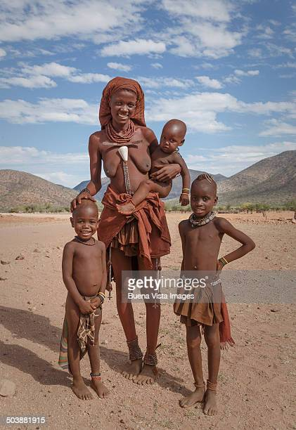 Young Himba woman with daughters