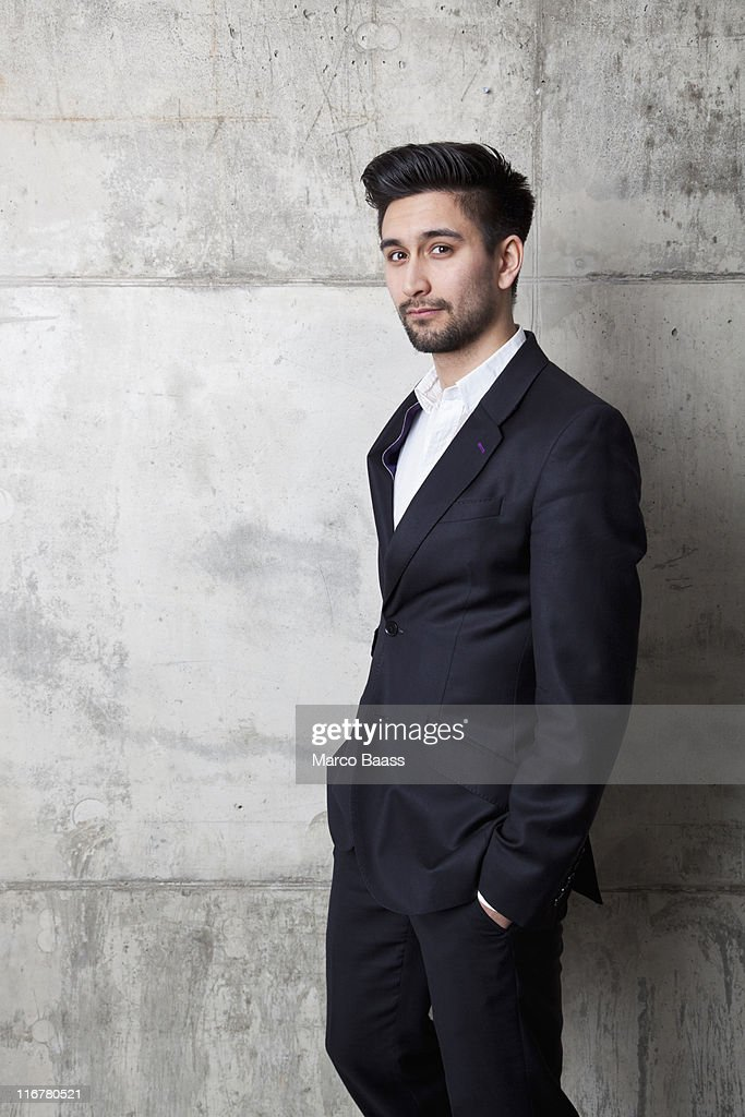 A young hip businessman with his hands in his pockets : Stock Photo