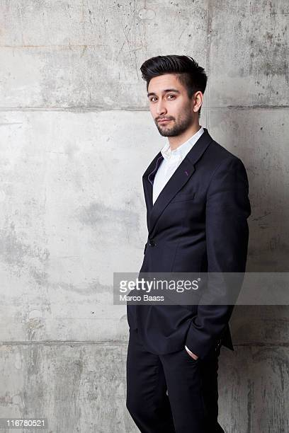a young hip businessman with his hands in his pockets - open collar stock photos and pictures