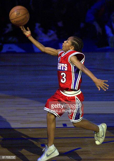 Young hiphop star 'Lil Bow Wow runs down the NBA All Star Game court while crews shoot film footage for his new movie Like Mike during the Slam Dunk...