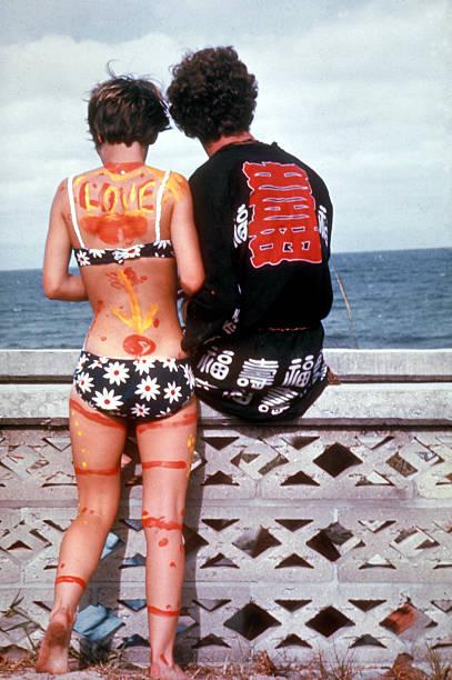 Young hippie couple, she bikini clad and