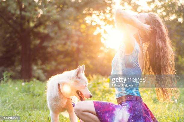 Young hippie girl enjoying the day with her dog