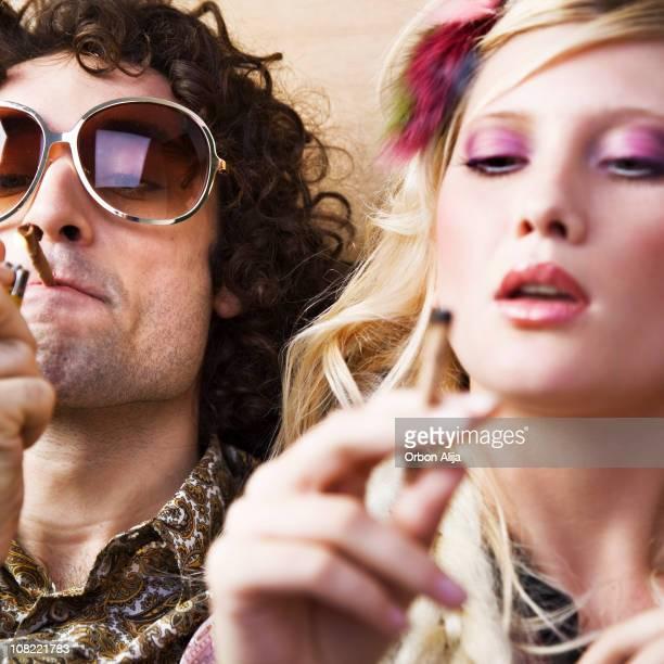Young Hippie Man and Woman Smoking Marijuana