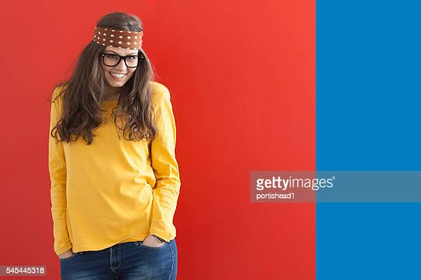 Young hippie woman on red-blue background