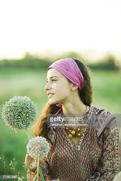 Young hippie woman with allium, portrait
