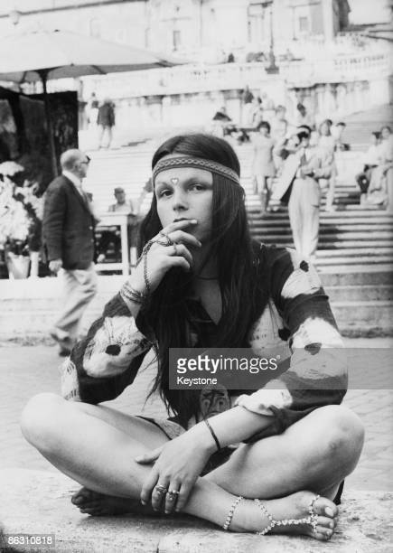 A young hippy sits crosslegged in the Piazza di Spagna at the bottom of the Spanish Steps in Rome 1970