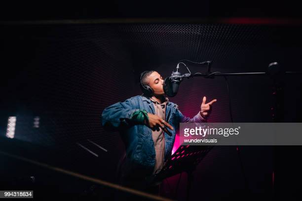 young hipster african-american rapper recording songs in music recording studio - sound recording equipment stock pictures, royalty-free photos & images