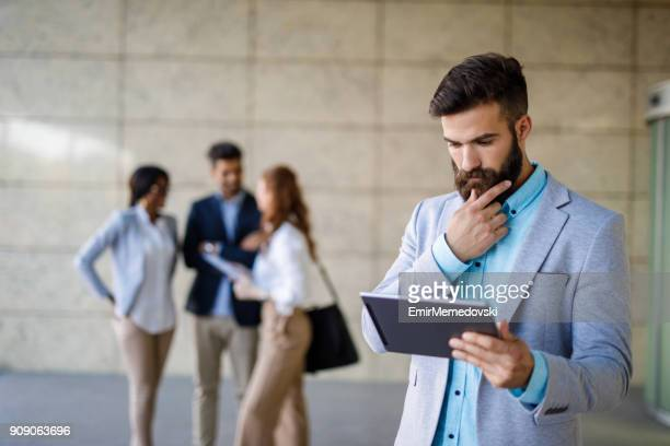 young hipster businessman holding digital tablet - emir memedovski stock pictures, royalty-free photos & images