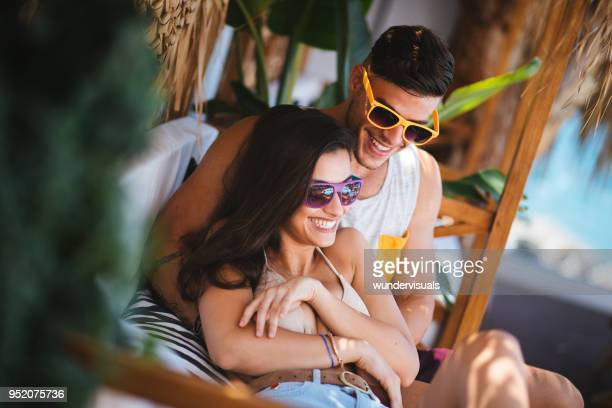young hipster couple having fun at summer beach cafe - hawaii beach stock pictures, royalty-free photos & images