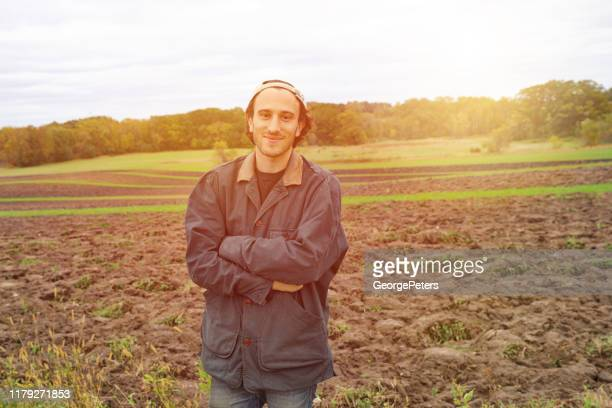 young hipster farmer - humility stock pictures, royalty-free photos & images