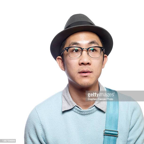 young hipster in fedora and glasses - fedora stock pictures, royalty-free photos & images