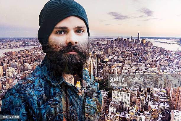 young hipster man in new york - double exposure - brown hat stock photos and pictures