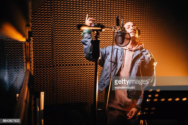 young hipster rap music singer recording song in music studio - rap stock pictures, royalty-free photos & images