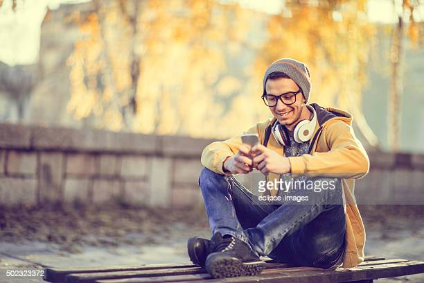 Young hipster using a mobile phone