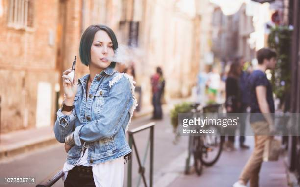 young hipster vape on the street - bohemia czech republic stock pictures, royalty-free photos & images