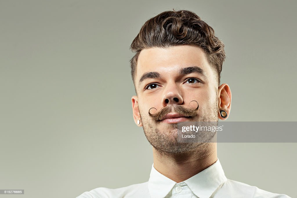 young hipster with long moustaches : Stock Photo