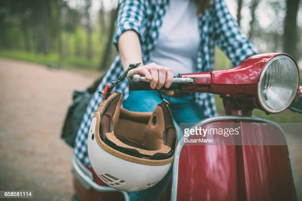 young hipster woman in helmet sitting on a vintage scooter . - hard hat stock pictures, royalty-free photos & images