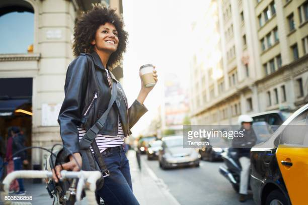Young hipster woman in the streets of Barcelona commuting.