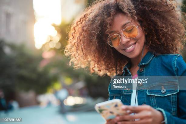 young hipster woman in the streets of barcelona. - millennial generation stock pictures, royalty-free photos & images