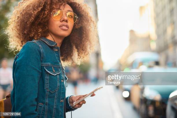 Young hipster woman in the streets of Barcelona.