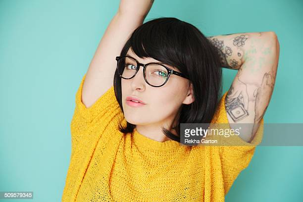 Young hipster woman with tattoos in bright colours