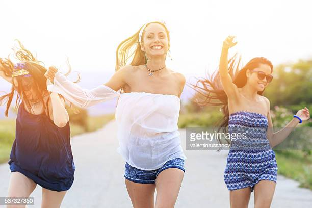 Young hipster women having fun on the road