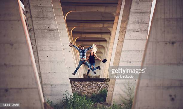 Young hipsters having fun on railroad